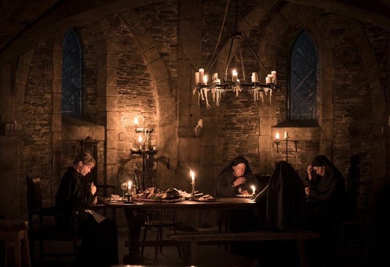 Father Ignatius (Sam Reid) and the nuns in a candlelit scene from 'Lambs of God' - DOP Don McAlpine ACS ASC, PHOTO Mark Rogers