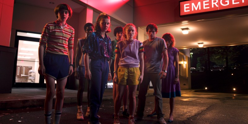 (L-R) Noah Schnapp, Caleb McLaughlin, Millie Bobby Brown, Finn Wolfhard, Sadie Sink, Charlie Heaton and Natalia Dyer in Season Three of 'Stranger Things' - IMAGE Netflix
