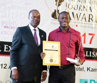 Andrew Bagala (right), Daily Monitor, celebrates his win of the investigative reporting award.