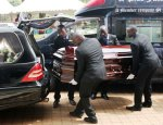 The casket containing Kasiwukira's body being carried to the church on Sunday (Photo by Michael Nteza/ChimpReports)