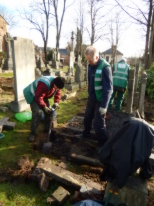 The guys straightening up some of graves