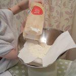Flour being measured