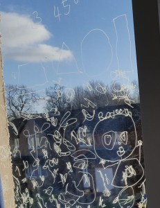 The boys' art on a window from last year