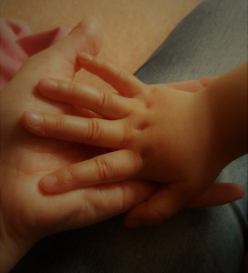 Youngest's hand in mine