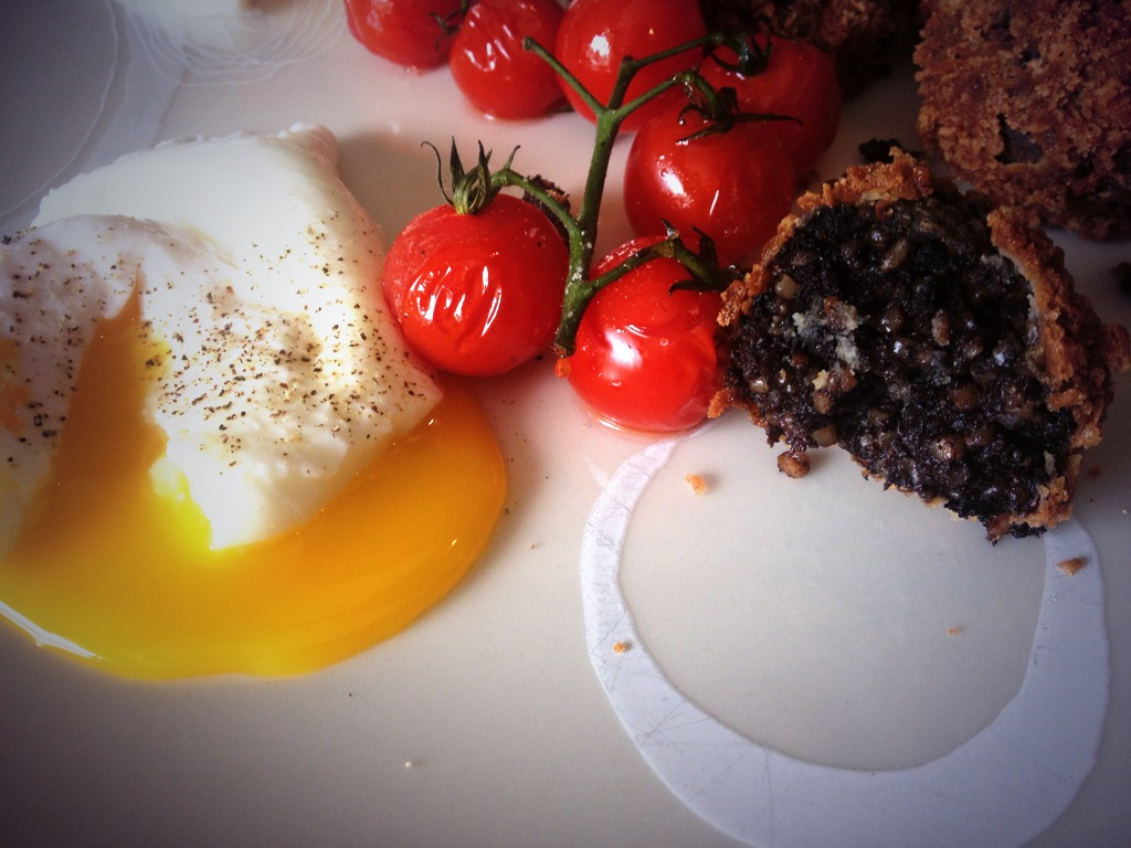 Crispy Black Pudding Croquettes with Poached Eggs and Tomatoes