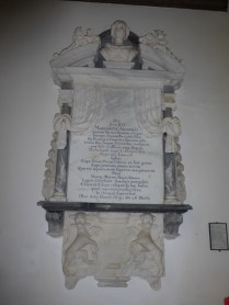 An Arundell memorial with bearded dogs