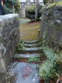 St Ewe: the cattle grid entrance to the churchyard