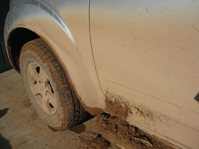 Look at all of the mud accumulated on my tire, wheel well and running board.