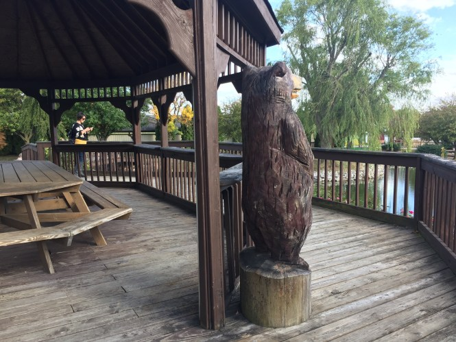 Hand carved wooden bear near the picnic gazebo