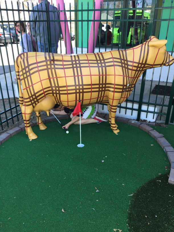 Me getting out from behind the plaid cow.