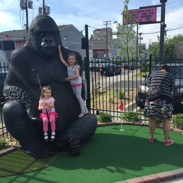 Me putting with Mr. Tee's nieces monkeying around, back in June.