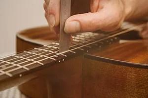 acoustic guitar setup measuring string height