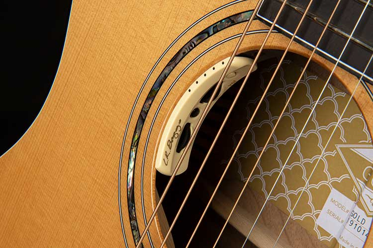 Closeup photo of the Cort Gold-Edge acoustic-electric guitar's soundhole mounted L.R. Baggs Anthem preamp controls
