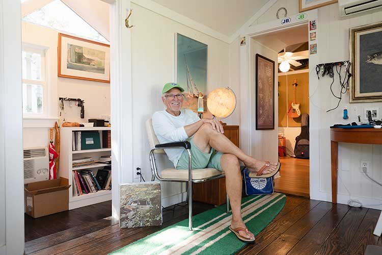 Jimmy Buffett sitting in a chair in his home