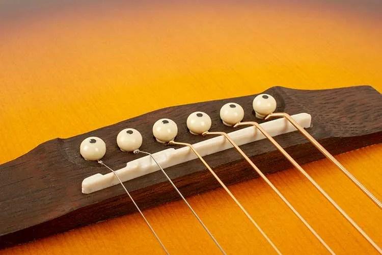 compensated bridge on acoustic guitar