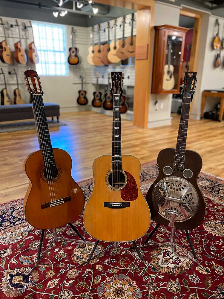 Gruhn Guitars in Nashville offers new and used instruments.  In the photo, from left to right: a 1966 Ramirez José Flores flamenco, a 1953 Martin D-28 personalized for Charlie Louvin and a 1932 round neck Dobro.