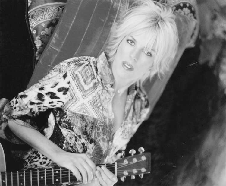 Lucinda Williams with guitar in 2003. Photo by Danny Clinch