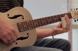 acoustic guitar being played with slide