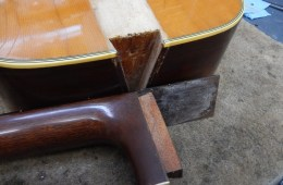 closeup of a martin acoustic guitar neck joint with the neck detached