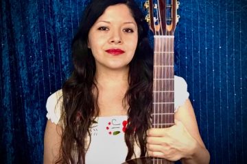 Claudia Garcia with acoustic guitar