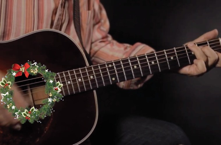 acoustic guitar with a christmas wreath soundhole
