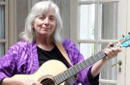 Cathy Fink holding acoustic guitar American Roots Licks for Warming Up or Composing