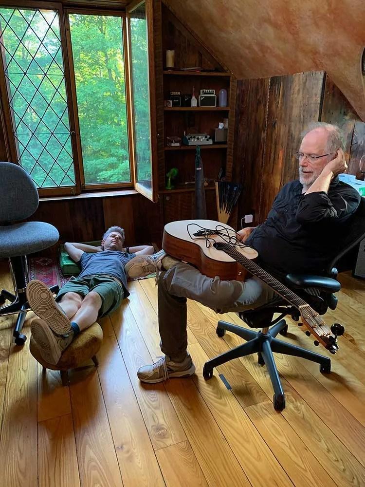Color photo of Mike Gordon and Leo Kottke listening to recorded tracks in Kottke's home studio