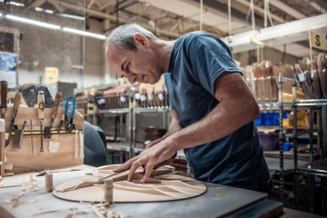 Martin Guitar CEO Thomas Ripsam works on scalloped bracing.