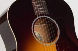 Collings CJ45 T acoustic guitar closeup showing the soundhole, strings, and sunburst finish