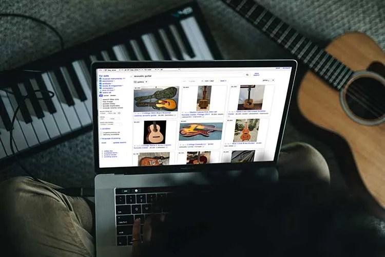 open laptop computer showing a website that sells guitars