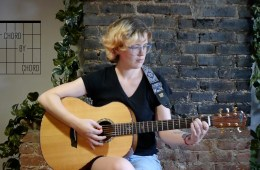 kate koenig teaches chord progression on acoustic guitar