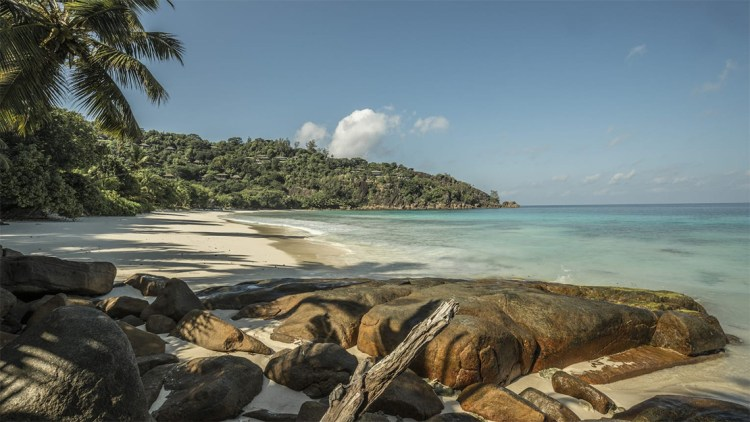 White sands and rock boulders in Petite Anse Beach, very near the Four Seasons Resort Seychelles