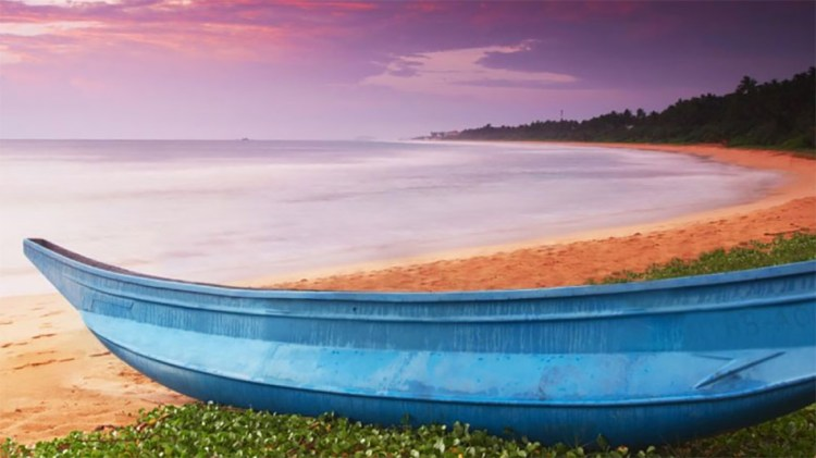 Lovely colours of a sunset in Bentota Beach from the Taj Bentota Resort and Spa