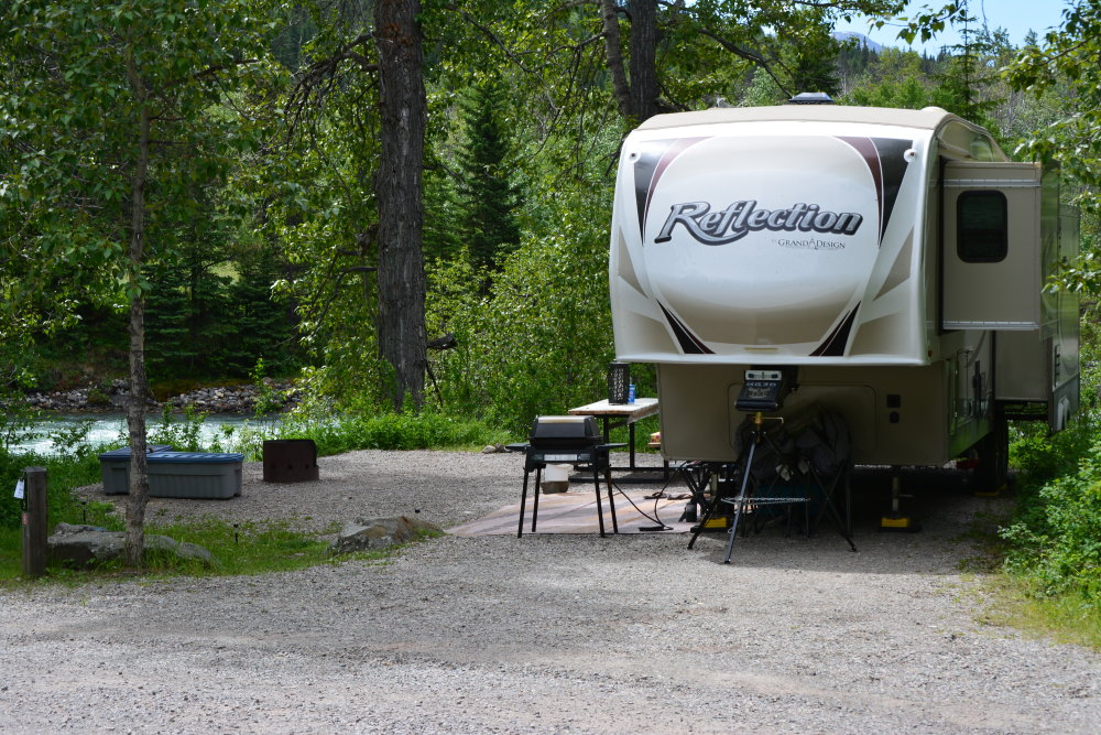 RV on river side campsite at Castle Falls Campground