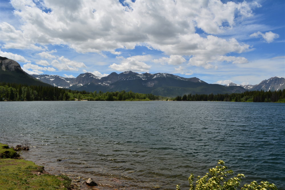 view across a lake with mountains in distance