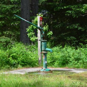 rusted, green hand pump