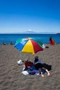 Views across Lake Llanquihue to Osorno Volcano from the beach at Puerto Varas