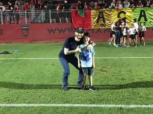 Matt Robards and son on field Phoenix Rising