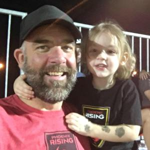Arran Airs with his daughter at Phoenix Rising game