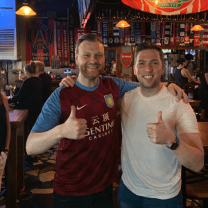 Callum Williams and Kevin Egan celebrate Aston Villa win