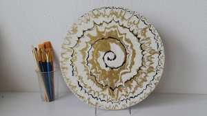 Fluid acrylic painting video. How to spin a record on a cake turntable to pour a spiral painting using acrylic paints.