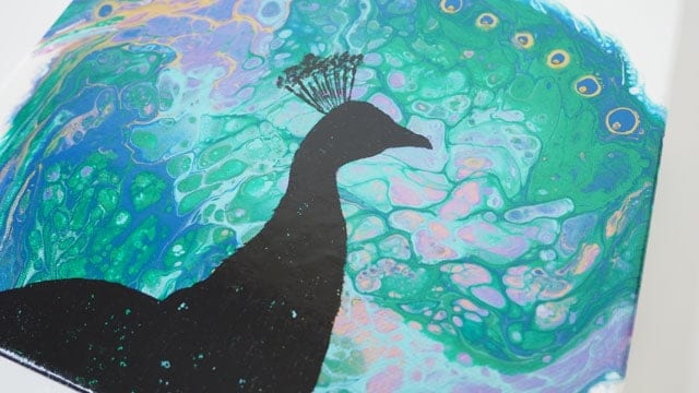 Painting a silhouette on your acrylic poured background using a template - video shows you how