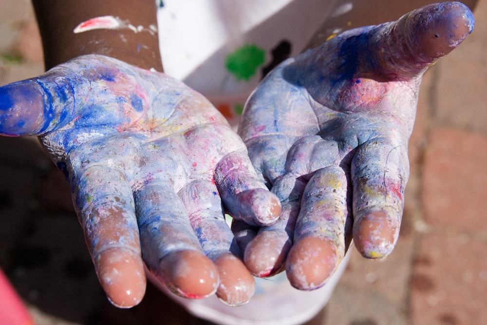 hands with paints