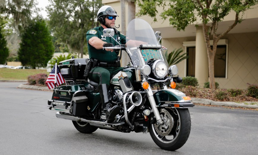 Deputy Avery on a Sheriff's Office Harley Davidson motorcycle