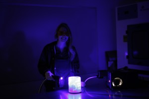 Forensics personnel using an alternate light source