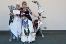 Cosplayers dressed as Navi and Zelda.