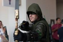 'Arrow' threatens an evil-doer on the convention floor.
