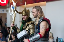Loki and Thor chat in the middle of a photo session.