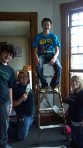 Youth from Teens for Change painting and cleaning a local homeless shelter.