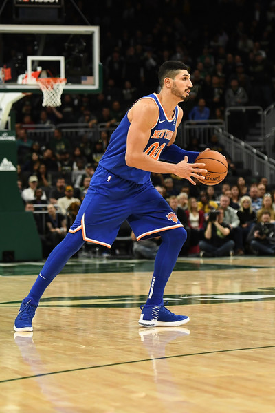 Enes Kanter makes a pass for the New York Knicks